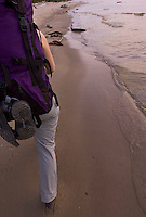 A backpacker hikes the Lake Superior shoreline at Mosquito Beach in Pictured Rocks National Lakeshore near Munising, Michigan.