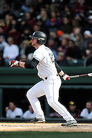 Designated hitter Alex Destino (24) of the South Carolina Gamecocks bats in the Reedy River Rivalry game against the Clemson Tigers on Saturday, February 28, 2015, at Fluor Field at the West End in Greenville, South Carolina. South Carolina won, 4-1. (Tom Priddy/Four Seam Images)