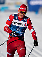 1st January 2020, Toblach, South Tyrol , Italy;  Alexander Bolshunov of Russia competes in the mens 15 km classic technique pursuit during Tour de Ski on January 1, 2020 in Toblach.