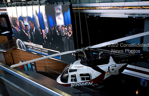 United States President Barack Obama is shown greeting guests on a television monitor during a town hall discussion on jobs and the economy hosted by CNBC at the Newseum in Washington, D.C., U.S., on Monday, September 19, 2010. .Credit: Joshua Roberts - Pool via CNP