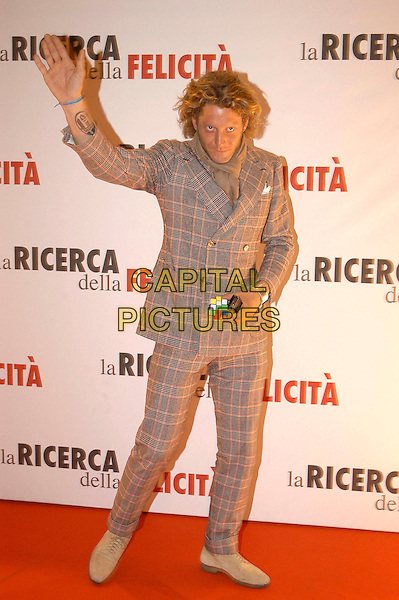 LAPO ELKANN.The premiere of ''Pursuit Of Happyness'' at the Auditorium Conciliazione in Rome, Italy.. January 11th, 2007.full length grey gray plaid pink suit rubik's cube tattoo waving hand.CAP/CAV.©Luca Cavallari/Capital Pictures
