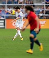ORLANDO, FL - MARCH 05: Sakai Kumagai #4 of Japan punts the ball forward during a game between Spain and Japan at Exploria Stadium on March 05, 2020 in Orlando, Florida.