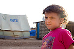 DOMIZ, IRAQ: A young Syrian refugee in the Domiz refugee camp in the Kurdish region of northern Iraq...The semi-autonomous region of Iraqi Kurdistan has accepted around 60,000 refugees from war-torn Syria. Around 20,000 refugees live in the Domiz camp which sits 60 km from the Iraq-Syria border...Photo by Younes Mohammad/Metrography