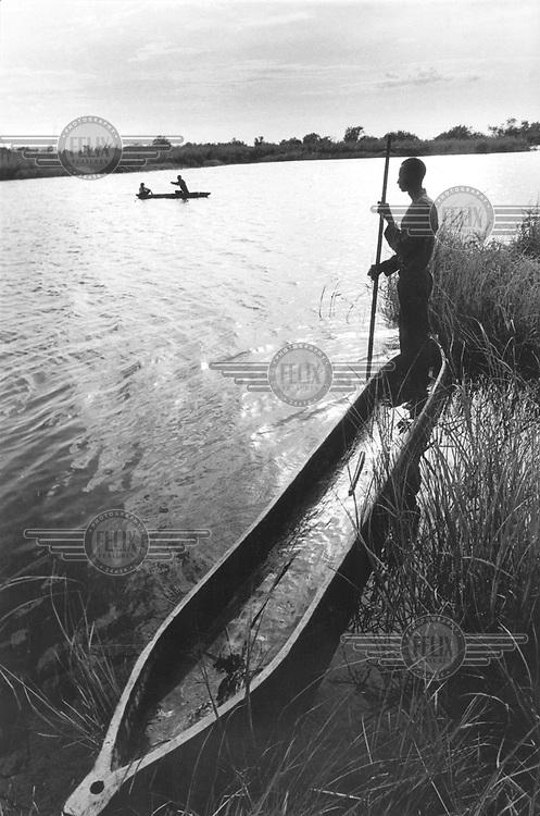 © Paul Weinberg / Panos Pictures..Okavango Delta, BOTSWANA..San Bushman crossing the Khoisan river.