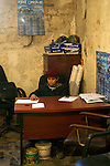 Mcc0030300 . Sunday Telegraph..A young revolutionary sits behind a desk in the media centre in Benghazi...Benghazi 25 March 2011