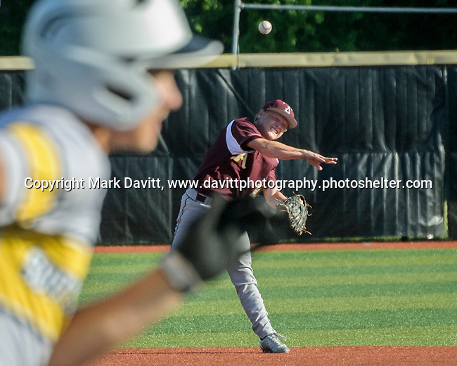 Southeast Polk and Ankeny met for a double header at SEP June 21. SEP prevailed twice, 2-0 and 8-1. AHS's Drew Hill knocks down a hard hit grounder and tries to make an out.