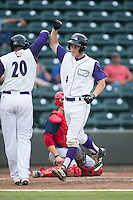 Toby Thomas (4) of the Winston-Salem Dash bumps arms with teammate Telvin Nash (20) after hitting a home run against the Potomac Nationals at BB&T Ballpark on July 15, 2016 in Winston-Salem, North Carolina.  The Dash defeated the Nationals 10-4.  (Brian Westerholt/Four Seam Images)