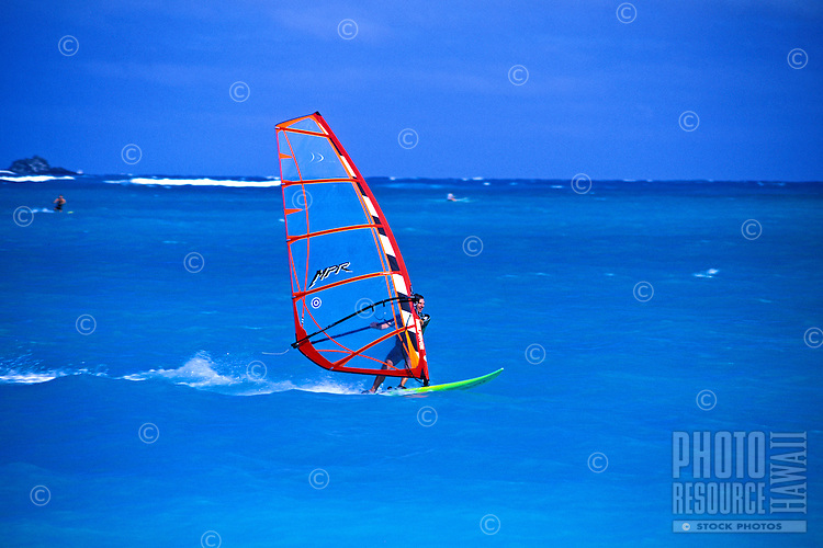 EDITORIAL ONLY.  Windsurfer flies over the turquoise waters off Kailua Beach, Oahu