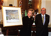 "First Lady Hillary Rodham Clinton announced the 1999 White House holiday theme ""Holiday Treasures at the White House"" in Washington, D.C. on December 6, 1999.  The 1999 White House Holiday Card (at left) features a watercolor painting depicting the North Portico.  The White House was chosen as the subject of President and Mrs. Clinton's holiday card to pay tribute to a true American treasure.  The card was created by artist Ray Ellis (at right) , of Martha's Vineyard, Massachusetts.  Mr. Ellis is known for his exquisite watercolor and oil landscapes.  He designed the 1998 White House Holiday card featuring a watercolor painting of the State Dining Room. The inside of the card reads: ""Our family wishes you and yours a blessed holiday season filled with treasured memories of past traditions and joy and peace in the new millennium.""  It is signed by the President and First Lady and embossed with the Presidential seal..Credit: Ron Sachs / CNP"