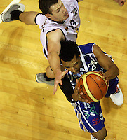 Saints import Mike Efevberha is pressured by Heat forward Daryl Cartwright during the National Basketball League match Wellington Saints and Harbour Heat at TSB Bank Arena, Wellington, New Zealand on Saturday 13 June 2009. Photo: Dave Lintott / lintottphoto.co.nz