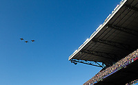 Another military flyover delighted fans at Husky Stadium.