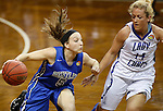 SIOUX FALLS MARCH 23:  Jane White #5 of Bentley drives toward Blair Taylor #14 of Lubbock Christian #14 during their 2016 NCAA Women's DII Elite 8 Basketball Championship semifinal game Wednesday night at the Sanford Pentagon in Sioux Falls, S.D. (Photo by Dick Carlson/Inertia)