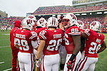 Wisconsin Badgers teammates huddle during warmups prior to an NCAA Big Ten Conference college football game against the Penn State Nittany Lions on November 26, 2011 in Madison, Wisconsin. The Badgers won 45-7. (Photo by David Stluka)