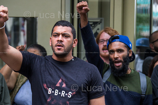 London, 17/08/2014. Today, &quot;London Black Revs&quot; held a demonstration outside the US Embassy in support and solidarity with Michael Brown and the people of Ferguson, Missouri. From the organisers online press release: &lt;&lt;On Saturday 9th August 2014 Unarmed Black Man Michael Brown was shot 8 times until he died, by a police officer in Ferguson, Missouri. Since the Murder Michael Brown has been portrayed like a thug by the Mainstream Media and Ferguson PD have violently suppressed all protests, supported by some sections of the media who have branded protests &quot;Riots&quot; and labelled protesters &quot;looters&quot;. London Black Revs are calling a Solidarity Vigil outside the U.S. Embassy to call for the US to stop violently oppressing, Black People and Black Protests. We stand with the family of murdered Michael Brown, and the people of Ferguson, Missouri in their fight for Truth, Justice and Peace I their community&gt;&gt;. Speakers included, amongst others, Carol Duggan (Mark Duggan's aunt) from the Justice for Mark Duggan Campaign and from the United Families and Friends Campaign, UFFC.<br /> <br /> For more information about the organiser please click here: http://on.fb.me/1tcEips