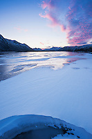 Snow drift on frozen lake Urvatnet, Lofoten Islands, Norway