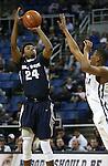 Utah State's JoJo McGlaston (24) shoots past Nevada defender Eric Cooper (21) during an NCAA college basketball game in Reno, Nev., on Tuesday, Jan. 20, 2015. Utah State won 70-54. (AP Photo/Cathleen Allison)