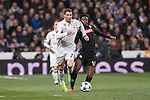 Cristiano Ronaldo of Real Madrid  fights for the ball with Amadou Diawara of SSC Napoli during the match Real Madrid vs Napoli, part of the 2016-17 UEFA Champions League Round of 16 at the Santiago Bernabeu Stadium on 15 February 2017 in Madrid, Spain. Photo by Diego Gonzalez Souto / Power Sport Images