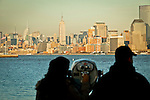 Tourist watch the middle Manhattan from the Liberty Island in New York, 9/01/12. New York City, with a population of over 8.1 million, is the most populous city in the United States. It is known for its status as a financial, cultural, transportation, and manufacturing center, and for its history as a gateway for immigration to the United States.   Photo by Eduardo Munoz Alvarez / VIEWpress.