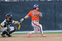 Center fielder Tyler Slaton (18) of the Clemson Tigers bats in a game against the Wofford College Terriers on Tuesday, May 5, 2015, at Russell C. King Field in Spartanburg, South Carolina. The catcher is Carson Waln. Wofford won, 17-9. (Tom Priddy/Four Seam Images)