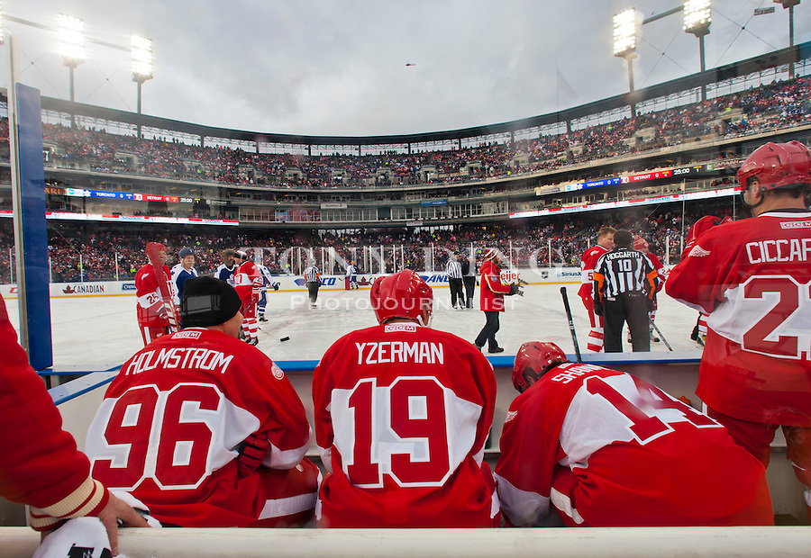 31 December 2013: Former Detroit Red Wings forward Tomas Holmstrom (96), forward and former captain Steve Yzerman (19), and forward Brendan Shanahan (14) sit together on the bench during the Toronto Maple Leafs v Detroit Red Wings Alumni Showdown hockey game, at Comerica Park, in Detroit, MI.
