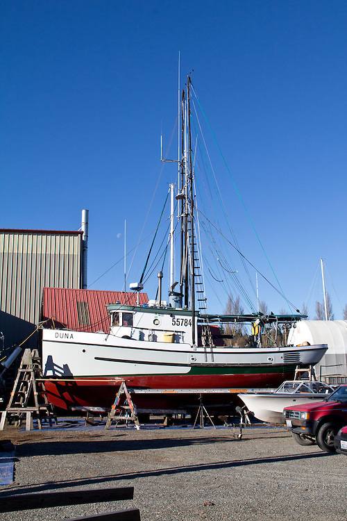 Fishing boat, Duna, Port Townsend, Port of Port Townsend, Boat Haven, classic salmon troller hauled out on the hard for maintenance, winter, Puget Sound, Jefferson County, Washington State, Pacific Northwest