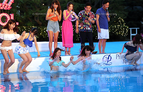 July 6, 2017, Tokyo, Japan - Japanese models Ikumi Hisamatsu (L) and Mai (2nd L) smile with comedian group Speedwagon, Jun Itoda (2nd R) and Kazuhiro Ozawa (R) as they attend an opening ceremony for a swimming pool of the Tokyo Prince hotel in Tokyo on Thursday, July 6, 2017. The hotel collaborate with female fashion magazine CanCam and will open a stylish hotel pool from July 8.     (Photo by Yoshio Tsunoda/AFLO) LwX -ytd-