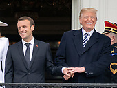 United States President Donald J. Trump and President Emmanuel Macron of France share smiles and a handshake as they pose for a photo following an arrival ceremony on the South Lawn of the White House in Washington, DC on Tuesday, April 24, 2018.<br /> Credit: Ron Sachs / CNP