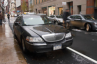 New York, NY -1  December 2007 Cyclist veers around a Taxi and Limosine Commission (TLC)  car blocking the new Prince Street shared lane.