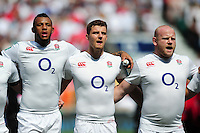 Courtney Lawes, Ollie Devoto and Dan Cole of England sing the national anthem. Old Mutual Wealth Cup International match between England and Wales on May 29, 2016 at Twickenham Stadium in London, England. Photo by: Patrick Khachfe / Onside Images