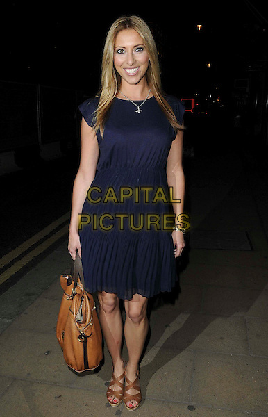 Kate Walsh.Macmillan De'Longhi Art Auction 2011 arrivals, Bonhams, New Bond Street, London, England..September 27th, 2011.full length blue dress brown bag purse shoes tan.CAP/CAN.©Can Nguyen/Capital Pictures.