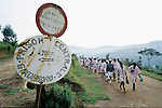 GIKONGORO, RWANDA - FEBRUARY 14: Prisoners accused of genocide in 1994 walk to work in a nearby field February 14, 2003 outside Gikongoro Prison in Gikongoro, Rwanda. About 100,000 prisoners accused of genocide are still in prisons nine years after 800,000 mainly Tutsis and moderate Hutus were killed in about one hundred days in 1994. Rwanda is currently trying to cope with these problems of crime, punishment and reconciliation through village trials called Gacacas. Gacaca, which means on the grass, is a traditional way of solving disputes between local communities and involve juries of residents. 11,000 gacacas are currently trying to resolve crimes from the genocide. (Photo by Per-Anders Pettersson)