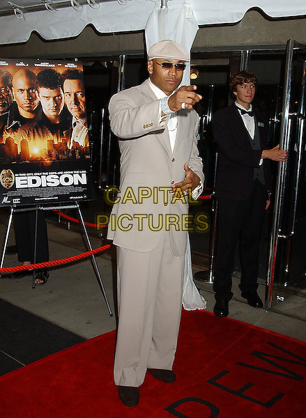 "LL COOL J.Attends the ""Edison"" World Premiere held at Roy Thomson Hall during The Toronto Film Festival,.Toronto 17th September 2005.full length cream beige suit cap sunglasses finger hand.Ref: ADM/LF.www.capitalpictures.com.sales@capitalpictures.com.© Capital Pictures."