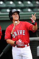 Third baseman Michael Chavis (11) of the Greenville Drive during a Media Day first workout of the season on Tuesday, April 7, 2015, at Fluor Field at the West End in Greenville, South Carolina. (Tom Priddy/Four Seam Images)