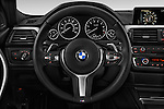 Car pictures of steering wheel view of a 2015 BMW 3 Series 328d xDrive Sports Wagon 5 Door Wagon Steering Wheel