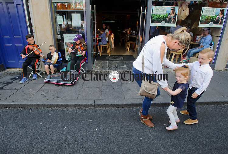 Dancing to the sounds of Lorcan, Ronan and Cathy Garland of Down on O Connell street, Ennis during Fleadh Cheoil na hEireann. Photograph by John Kelly.