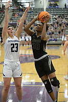Bentonville's Maryam Dauda (right) takes a shot in the lane Friday, Jan. 17, 2020, as Fayetteville's Caroline Lyles defends during the second half of play in Bulldog Arena in Fayetteville. Visit nwaonline.com/prepbball/ for a gallery from the games.<br /> (NWA Democrat-Gazette/Andy Shupe)
