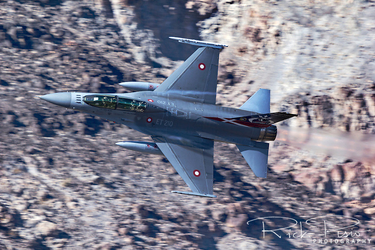 Royal Danish Air Force F-16 in afterburner during low level flight over California's Mojave Desert.