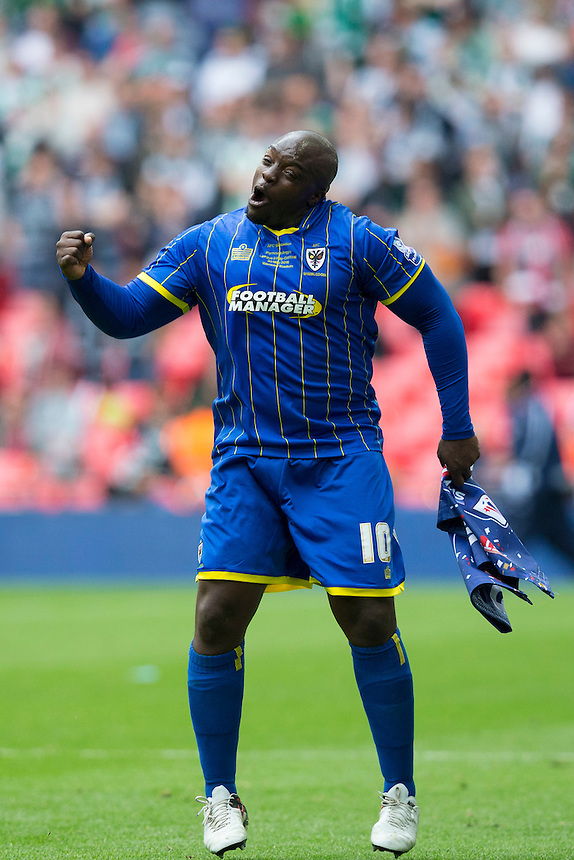 AFC Wimbledon's Adebayo Akinfenwa celebrates his side's 2-0 victory at full time<br /> <br /> Photographer Craig Mercer/CameraSport<br /> <br /> Football - The Football League Sky Bet League Two Play-Off Final - AFC Wimbledon v Plymouth Argyle - Monday 30 May 2016 - Wembley Stadium - London<br /> <br /> World Copyright &copy; 2016 CameraSport. All rights reserved. 43 Linden Ave. Countesthorpe. Leicester. England. LE8 5PG - Tel: +44 (0) 116 277 4147 - admin@camerasport.com - www.camerasport.com