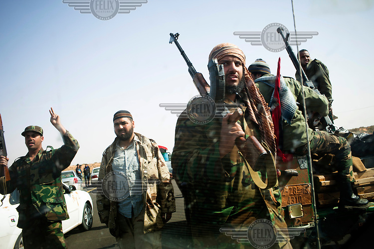 Rebels gatehr at the frontline near Brega. On 17 February 2011 Libya saw the beginnings of a revolution against the 41 year regime of Col Muammar Gaddafi.