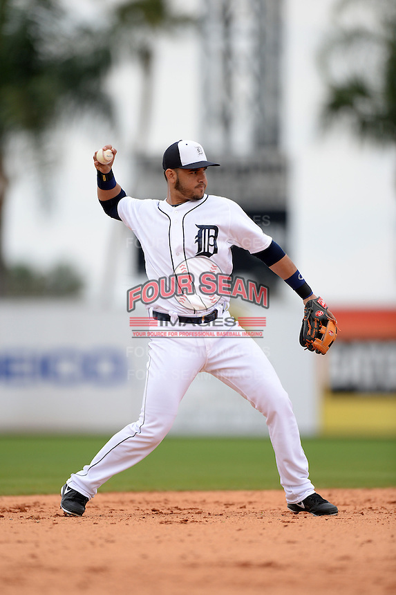 Detroit Tigers shortstop Eugenio Suarez (27) during a spring training game against the Atlanta Braves on February 27, 2014 at Joker Marchant Stadium in Lakeland, Florida.  Detroit defeated Atlanta 5-2.  (Mike Janes/Four Seam Images)