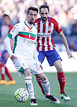 Atletico de Madrid's Juanfran Torres (r) and Granada Club de Futbol's Isaac Cuenca during La Liga match. April 17,2016. (ALTERPHOTOS/Acero)