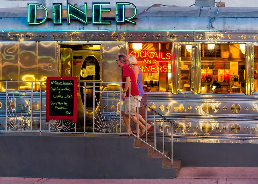 Miami Beach - Circa 2012: Couple walking into a retro diner in Miami Beach. Editorial Usage Only.