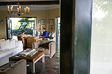 BELIZE, Punta Gorda, Toledo, Belcampo Belize Lodge and Jungle Farm, guests sit and work in the main lobby