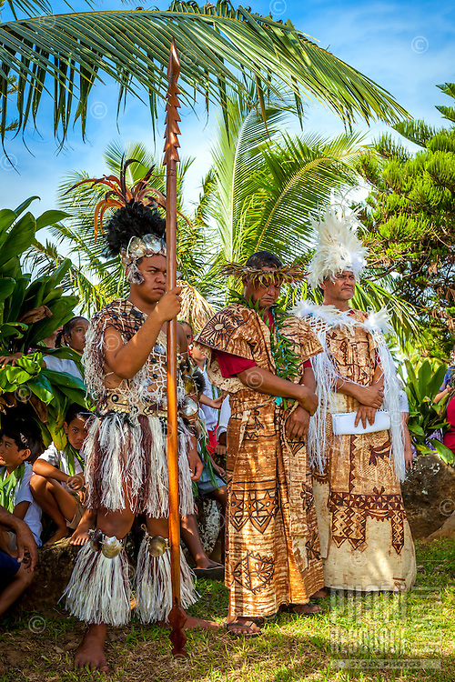 Men in traditional attire witness Makirau Haurua's investiture with the Teurukura Ariki title, Aitutaki Island, Cook Islands.