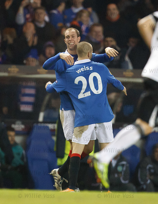 Steven Whittaker scores for Rangers and celebrates