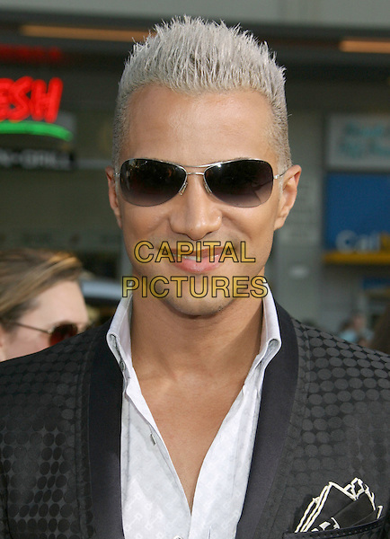 "JAY MANUEL.""The Invention Of Lying"" Los Angeles Premiere held at Grauman's Chinese Theatre, Hollywood, California, USA..September 21st, 2009.headshot portrait sunglasses shades white grey gray.CAP/ADM/MJ.©Michael Jade/AdMedia/Capital Pictures."