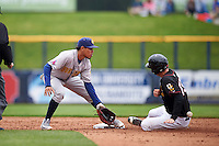 Burlington Bees shortstop Juan Moreno (2) waits for a throw as Kyle Tucker (19) slides in during a game against the Quad Cities River Bandits on May 9, 2016 at Modern Woodmen Park in Davenport, Iowa.  Quad Cities defeated Burlington 12-4.  (Mike Janes/Four Seam Images)