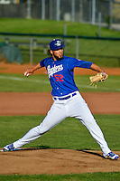 Ogden Raptors starting pitcher Miguel Urena (52) delivers a pitch to the plate against the Idaho Falls Chukars in Pioneer League action at Lindquist Field on June 28, 2016 in Ogden, Utah. The Raptors defeated the Chukars 12-11.  (Stephen Smith/Four Seam Images)