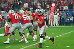 Ohio State Buckeyes quarterback Justin Fields (1) unleashes a pass during the Fiesta Bowl game against the Clemson Tigers on Saturday, Dec 28, 2019 in Glendale, Ariz.  (Gene Lower via AP)