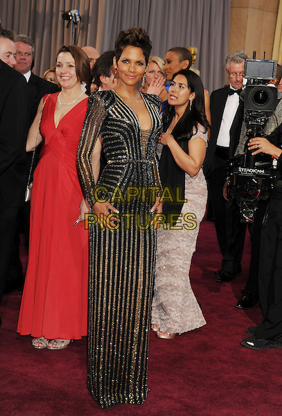 Halle Berry.85th Annual Academy Awards held at the Dolby Theatre at Hollywood & Highland Center, Hollywood, California, USA..February 24th, 2013.oscars full length black gold silver striped stripes dress long sleeves cleavage.CAP/ROT/TM.©Tony Michaels/Roth Stock/Capital Pictures